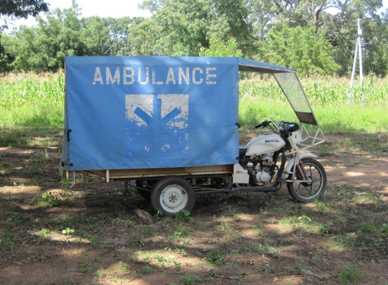 Motor cycle ambulance used to transport patients in rural Burkina Faso